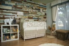 By KIM LEWIS DESIGNS  A special nursery for baby Murray.   Crib - Bratt Decor   Barnwood Wall - Barnwood Naturals  Flooring - Armstrong  Bedding - Serena & Lily  Fuzzy Animals - Roost  Ottoman - Aiden Gray