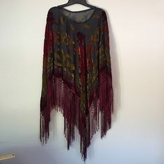 Shawl ( poncho style ) Velvet burnout with knotted fringe. Purchased from wholesale importer. Never worn or laundered.  30% silk, 70% rayon.  Dry clean only. Accessories Scarves & Wraps