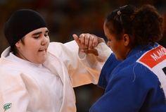 Wojdan Shaherkhani - Saudi Woman's Historic Judo Match, In Pictures