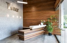 SIGNAGE concrete and wood elements Turner Constructions San Diego Offices / ID Studios reception desk Modern Reception Desk, Office Reception Area, Reception Desk Design, Hotel Reception, Reception Counter, Reception Areas, Corporate Interiors, Office Interiors, Commercial Design