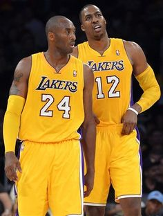 8168d78bb Los Angeles  Lakers guard Kobe Bryant and center Dwight Howard appear  during the first half