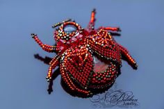 Beetle red Ammolite brooch 3D petrified wood,japanese beads, Czech crystal.Beadwork brooches.Beaded beetle.Bead Embroidery by NadezhdaBelokon on Etsy https://www.etsy.com/listing/484523801/beetle-red-ammolite-brooch-3d-petrified