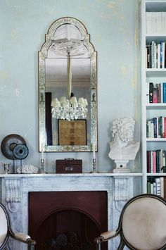 A verre églomisé mirror by Julian Chichester hangs over the original Carrara marble mantel in the library. The Head of Laocoon bust is from Howell and Howell Antiques Julian Chichester, Country Style Living Room, Marble Bust, Comfortable Sofa, Storage Shelves, Shelving, Bed And Breakfast, Armchair, Blog