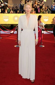 Tilda Swinton solidified the night's gray trend in an elegant long-sleeved Lanvin jersey gown.