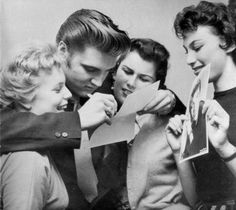 Elvis and fans backstage at the Shrine Auditorium in Los Angeles, CA, June 8, 1956