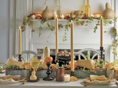 Layering the Thanksgiving table with amber-hued glassware and gourds, taper candles, and clusters of nuts lends it an aura of elegance. Photo Credit: Francine Zaslow #thanksgiving