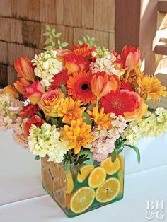 Give your Thanksgiving table decor some color. Orange slices set the tone for this cheerful arrangement of roses, gerbera daisies, stock, chrysanthemums, and tulips. Lemons, limes, and oranges make colorful embellishments in clear vases. Cut the fruit in slices or wedges, or leave them whole.