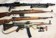 Most common German small arms of World War II.From top to down:Machinengewehr 34 (MG34)Gewehr 43 (G43)Karabiner K98k (K98)Sturmgewehr 44 (StG44)