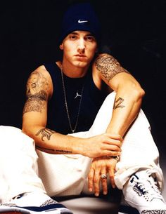 I am who I am and I say what I think. I'm not putting a face on for the record. ~Eminem