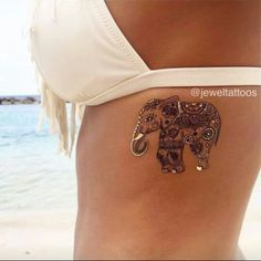 Love the style of this incorporated in the other elephant tat of mom and baby