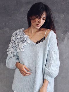 Knitted sweater with silk flowers