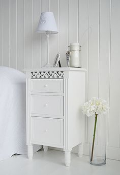 Bedside cabinet in white with three drawers for storage. Bedside tables, decor and bedroom furniture for Coastal, white, New England, French, Scandinavian homes from the White Lighthouse. Order online with fast delivery.
