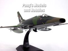"""1:72 Scale Metal Diecast - North American F-100 (F-100D) Super Sabre – Length: 7.5"""" Wingspan: 6.25"""" This model is a single seat and does not include a pilot figure. The canopy is glued shut. This mode"""