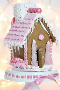 Shabby Chic! I'm not into gingerbread houses, but this one is so pretty. Especially love the rock candy trees flanking the front door and the shimmery pink accent balls on the roof.