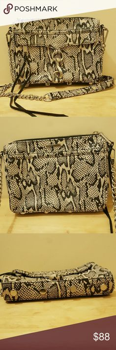 Mini M.A.C Snake print Snake print rebecca minkoff mini MAC crossbody.  100% real Leather (Saffiano Leather). Great condition, 2 small white nailpolish stains INSIDE of bag on the black lining . I will try to remove the stain when you  purchase it, no guarantee it will come out.  Scratching on metal  clasp  see pic. 3.  Front zip compartment, main compartment, & interior back wall pocket  Measurements: 6 1/3 in. H   x   8 1/2 in. L   x   2 in. W Rebecca Minkoff Bags Crossbody Bags