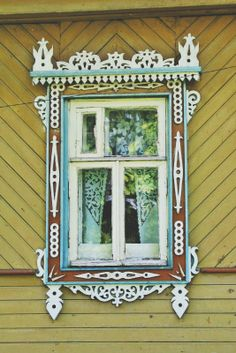 traditional decorative carved wood window frame, volga district, russia | architectural details