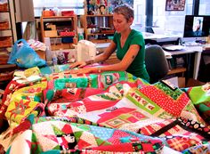 """Kitchen Sink Quilts - every year this quilter incorporates all her orphan blocks and leftovers into one quilt called """"Everything But the Kitchen Sink."""" What a fun idea."""