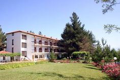 Milionis Forest Hotel Grevena Nestled amidst a forest with oak, pine and fir trees, Milionis Forest Hotel is located in Grevena-Kalambaka national road. It offers tastefully decorated rooms opening to a balcony, and a bar. Free Wi-Fi is available in public areas.