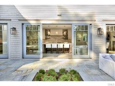 Like the sliding doors opening the middle of the kitchen to the back yard patio