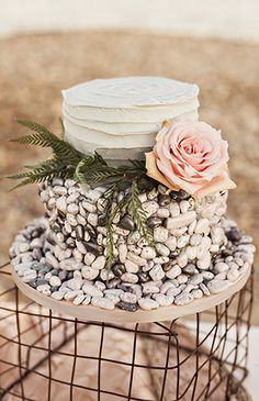 White wedding cake with stone detailing | New England Seaside Wedding Inspiration via @IBTblog, pics by Amilia Photography