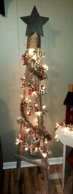 Primitive Tobacco Stick Tree...with RagLights and Twig Garland. Here, in Kentucky, we have lots of tobacco sticks and this is easy to make. Love this as a second tree in the country prim home.