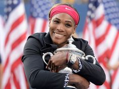 Serena Williams celebrates with the championship trophy after the match against Caroline Wozniacki.