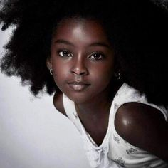 This little goddess is gorgeous. Her name is Cherelice. She is 6 years old and she is from Suriname.