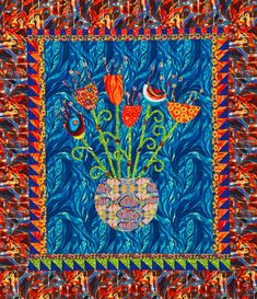 Use fusible appliqué and a small zigzag stitch to assemble an wall hanging. Bold prints make the flower bouquet look like a painting.