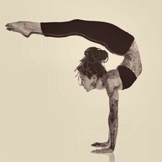 She is doing amazing yoga pose but love Her TATTOS!!!