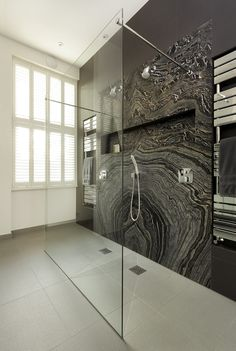 Get the look of a luxurious spa with a walk-through shower. Stunning marble brings a splash of natural beauty to this contemporary bathroom while a flush-fit shower tray creates a seamless finish.