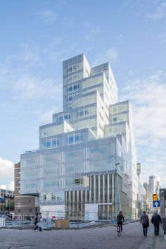 OMA has merged a municipal office block from the 1950s with a pixellated steel and glass structure