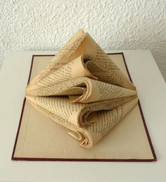 Book Art Sculpture Old book. $39.00, via Etsy.