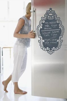 Chalkboard decal on stainless frig. Great idea!