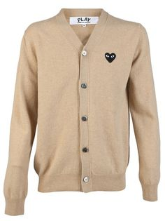 Signature cardigan from Comme des Garcons. This wool cardigan features a V-neck, front button down closure, long sleeves, and logo patch at left chest.