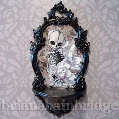 Memento Mori  Baby skeleton with orchids  by BrianaBainbridge