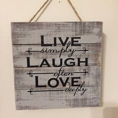 Dry brushed wooden sign with words; Live simply, Laugh often, and Love deeply.  Words will put a smile on anyones face.  Beautiful addition to any household no matter what type of decorating you like. Hang it in any room.  Measures 8 x 8.