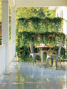 copper gutters ~ K-style gutters hung in tiers with chains & planted with ivy or other trailing vines to create a privacy wall for a backyard or porch | instructions via Martha Stewart