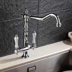 """Supplied with 1/2"""" bsp threads to this 2 hole mixer tap. Spout Projection: 215mm. Hot & cold water tap to create your perfect water temperature. Base to Spout: 215mm.   eBay!"""