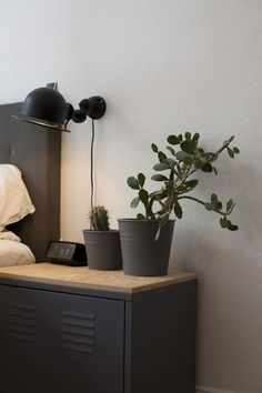 Hack your IKEA nightstand by painting it matte black for a look that will stand out.
