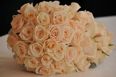Mini teardrop bridal bouquet of Champagne Roses