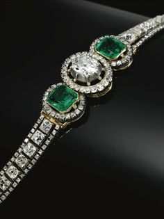 EMERALD AND DIAMOND BRACELET, MID 19TH CENTURY The cushion-shaped diamond collet set at centre between two step-cut emeralds, each within a border of circular-cut diamonds and accented with rose diamond points, to a bracelet designed as an articulated line of cushion-shaped diamonds between borders of circular-cut stones, length approximately 190mm, French assay marks.
