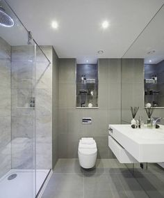 wall hung vanity, concealed cistern wc, marble/tiled walls