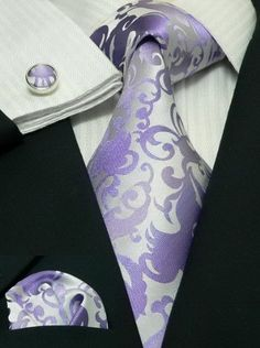 I like this set up of a classic black tux with purple accents