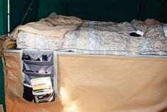 A bedside caddy serves as a makeshift nightstand.