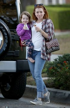 Eat and run: Alyson Hannigan packed a healthy bite while running errands with her adorable...