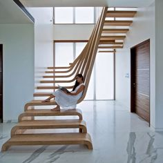 Arquitectura en Movimiento Workshop designed this amazing apartment in Mumbai, India that begs the question, sculpture or staircase? The stunning wood staircase structure is somewhat of an enigma, its...