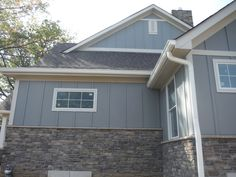 James Hardie fiber cement siding in Slate Gray. Hardie siding comes in a wide variety of colors and styles. It looks great on its one or paired with stone! Best Exterior House Paint, Exterior Siding Colors, Grey Siding, Building Exterior, Ranch Exterior, Vertical Siding, Siding Options, House Paint Color Combination, House Siding