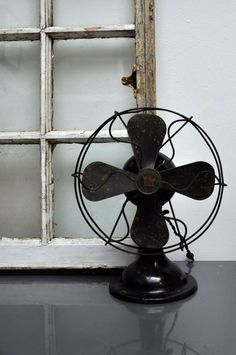the window is from a 100-year-old home that was torn down; the fan is from an antique market; designsponge.com