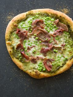 A delicious Spring pizza -- English pea burrata pizza from spoon fork bacon