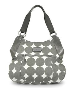 This mighty tote is ready for a day on the go. With the trendy silhouette of a hobo made with easy-to-clean polka dot coated canvas with faux leather accents and brushed nickel hardware, it combines the look of a sophisticated, oversize handbag with the functionality of a diaper bag. Front and back exterior zip pocket and zip side pockets keep Mom's essentials handy, while the super-roomy interior with slide pockets, changing pad stowage and a top zipper closure ...